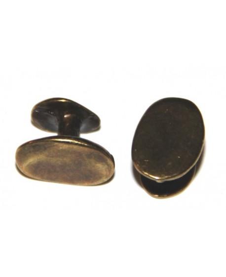 Chincheta plana  oval 18x6mm, separación 8mm, zamak baño de bronce